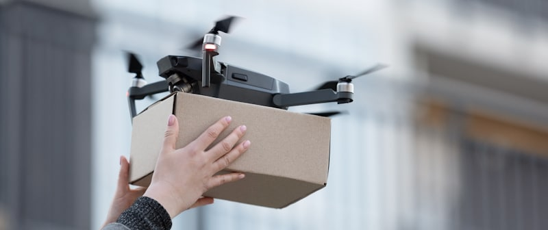 drone drops package in persons hands