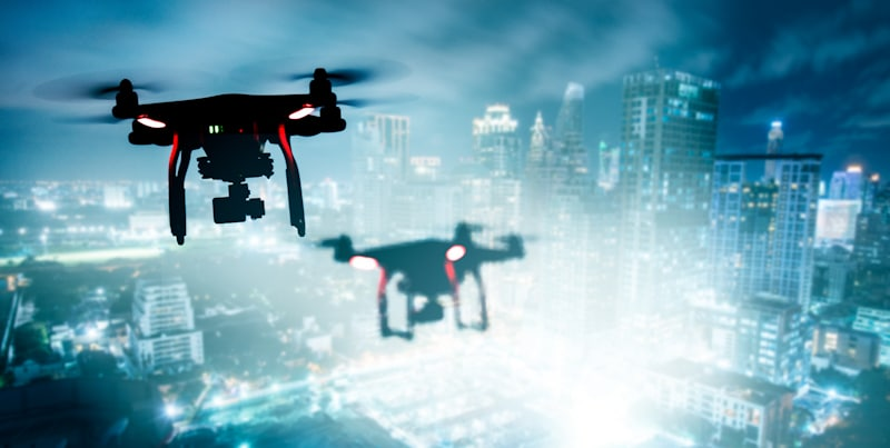 drones fly on city skylight at night