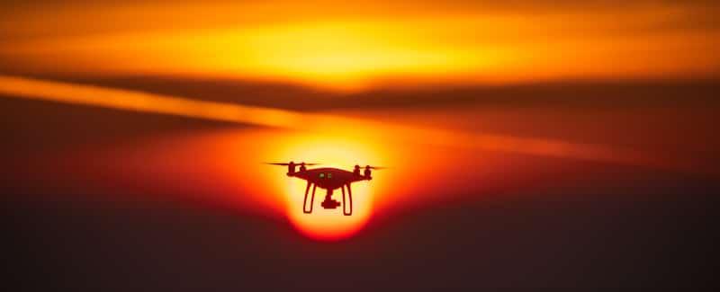 orange sky drone flying in sunset