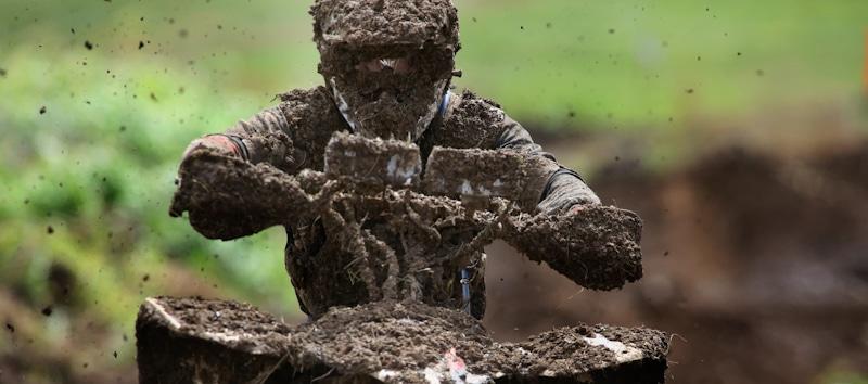 atv rider covered in mud