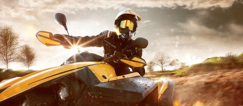 atv rider goes at high speed