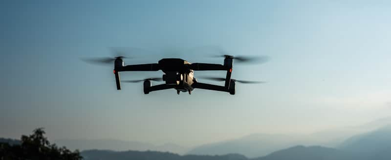 drone hovers in blue sky