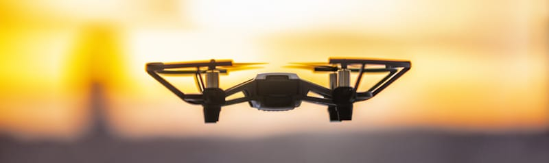 drone hovers in blurred sunset
