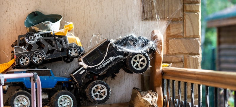 old rc cars covered in spiderweb